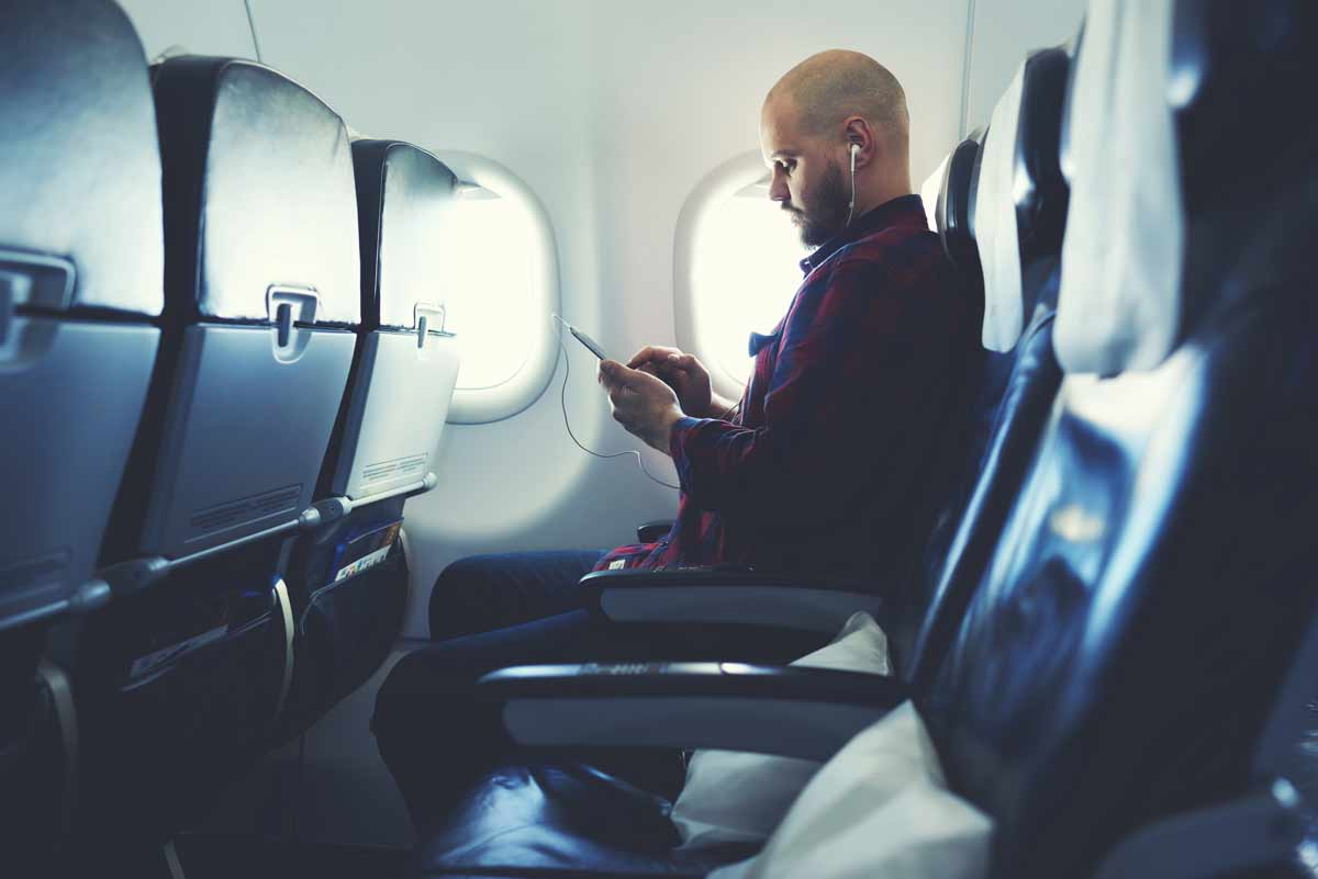 Man watching video on a plane